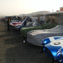 Early morning racecars under cover