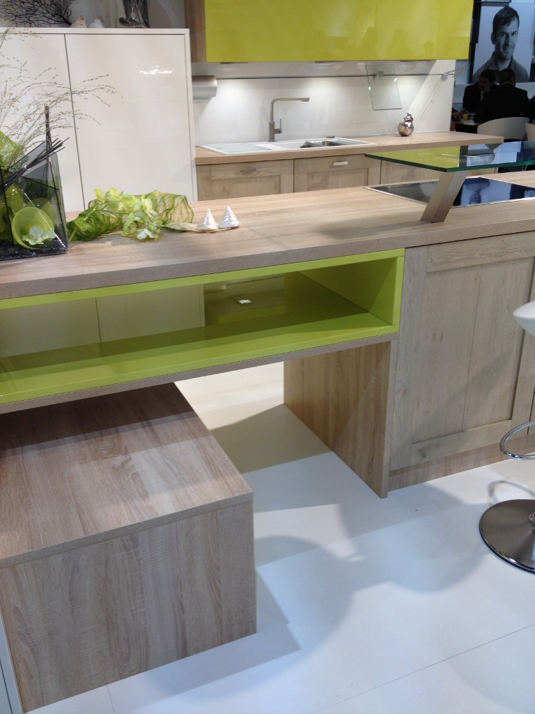 Natural wood, white and green kitchen cabinets