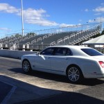 A Girl, A Bentley And A Racetrack