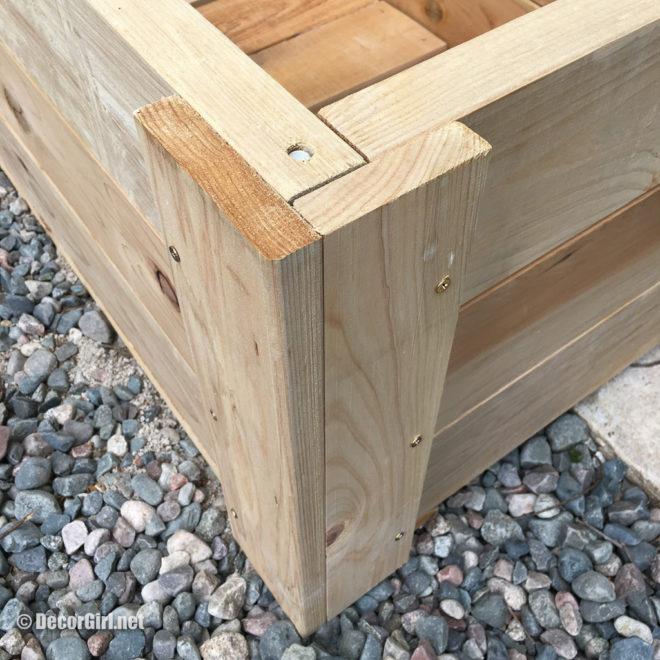 Corner finish pieces installed on cedar planter box