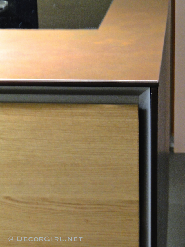 Wood cabinet with metal revea