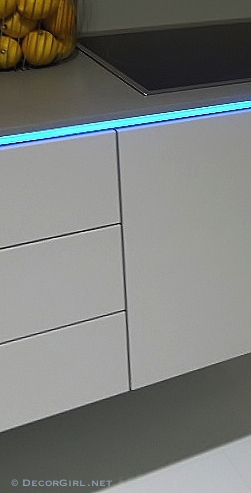 Lighted cabinet reveal