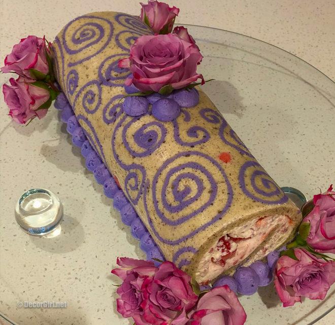 Decorated Jaconda sponge with purple jaconde paste rolled cake