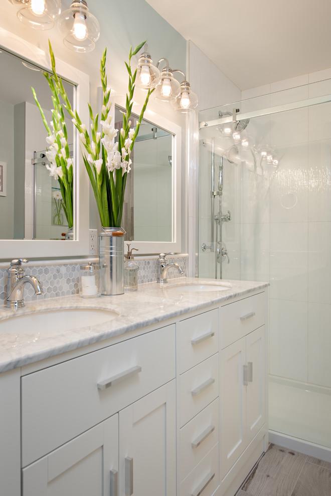 Tiled white bathroom