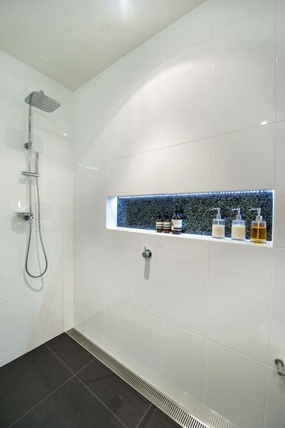 Tiled shower with linear drain